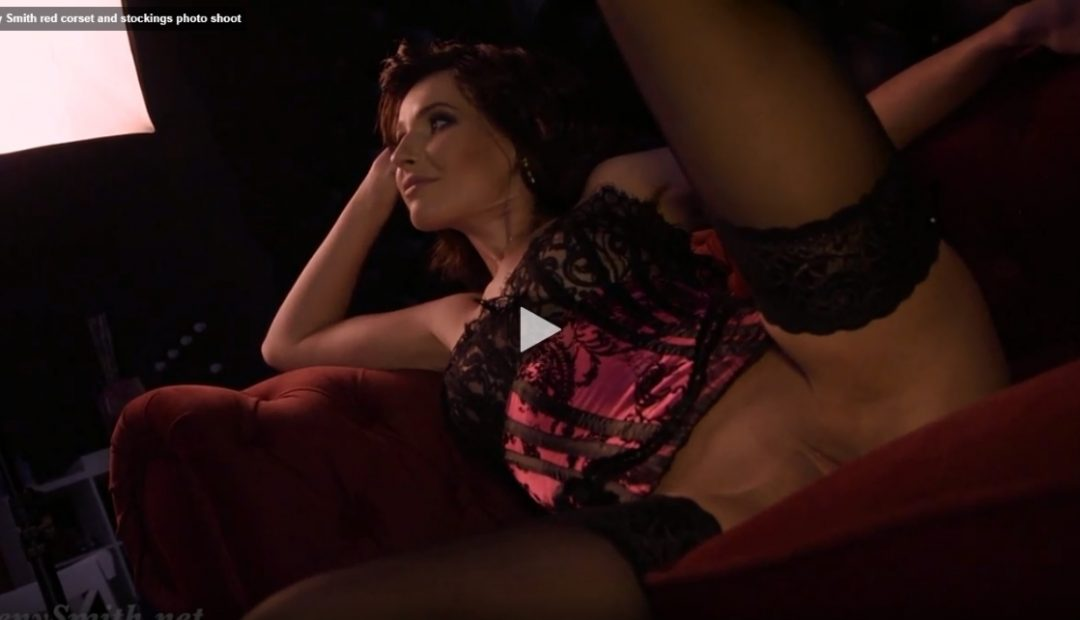 Jeny Smith Video: Red Corset and Stockings Photo Shoot